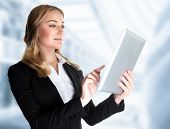 Closeup portrait of beautiful confident business lady working with touch pad in the office, modern t