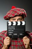 Funny scotsman with movie clapboard