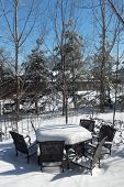 Backyard patio and outdoor furniture in winter