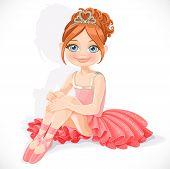 Ballerina girl in pink dress sit on floor