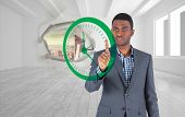 Composite image of focused businessman pointing to a clock