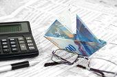 Swiss Banknote is folded as boat