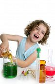 stock photo of little young child children girl toddler  - Beautiful chemistry little girl playing on a laboratory - JPG
