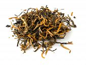 Indian black ASSAM gold tea isolated   on a white