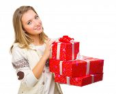 Young girl with gift boxes isolated