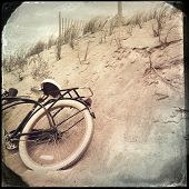 Instagram filtered image of an old bicycle and sand dunes