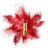 Red lipstick with powder explosion isolated on white background
