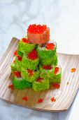 foto of avocado tree  - Maki Sushi Roll Christmas Tree on a table - JPG