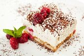 Berries Tiramisu Dessert with Cinnamon and Coffee. Garnished with Raspberry and Mint