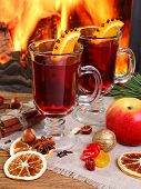 Mulled Wine - Two Glasses On The Background Of A Burning Fireplace