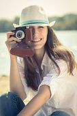 Young Hipster Girl With Old Film Camera At The Beach. Summer Vacation Background