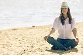 Young Woman In White Hat Relaxe At The Beach In Summer Midday