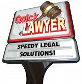Quick Lawyer sign advertising a law firm of attorneys promising speedy legal solutions to your problems or lawsuits