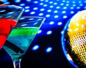 Blue And Red Cocktail With Golden Sparkling Disco Ball Background Selected Focus