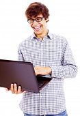 Young man reading something on laptop and loudly laughing at it isolated on white background