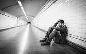 Young Man Lost In Depression Sitting On Ground Street Subway Tunnel