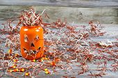 Scary Large Orange Pumpkin Jar On Rustic Wood