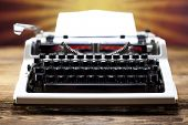 Retro typewriter with white paper