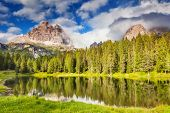 Great view of the foggy Lago Di Antorno in National Park Tre Cime di Lavaredo. Cadini di Misurina Ra