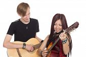 Young musicians with guitars. Asian woman and Caucasian man.