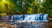 Tropical waterfall Phnom Kulen on sunrise, Cambodia