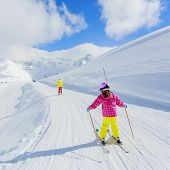 Skiing, winter, ski lesson - skiers on mountainside
