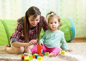 Mom And Child Daughter Play Block Toys Home