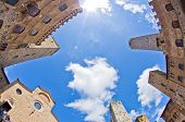 Fisheye view of San Gimignano towers and buidings on central square, Tuscany