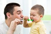 picture of pretty-boy  - child boy and his dad brushing teeth in bathroom - JPG