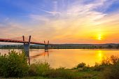 Cable stayed bridge over Vistula river in Poland at sunset.
