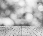 gray bokeh and wooden floor background