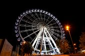 Working feris wheel at night in Zaragoza Spain