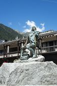 CHAMONIX, FRANCE - SEPTEMBER 02: Bronze statue of Michel Gabriel Paccard. In 1786, alongside Jaques Balmat, he was the first person to reach Mont Blanc's summit. September 02, 2014 in Chamonix.