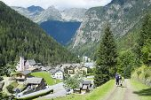 TRIENT, SWITZERLAND - AUGUST 31: Backpackers looking at Trient town, with Fontanabran mountain in th