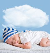 sleeping baby closeup portrait with cloud