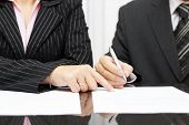 Business Woman  Show A Businessman  To Sign A Agreement