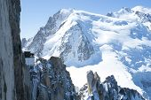 Mont Blanc mountain range, In Chamonix, France, with climbers on its rocks