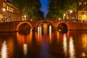 Night City View Of Amsterdam Canals And Seven Bridges