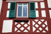 MUNSTERSCHWARZACH, GERMANY - 17 JULY: Half-timbered old house in Munsterschwarzach, Bavaria, Germany
