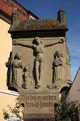 MUNSTERSCHWARZACH, GERMANY - JULY 17: A roadside crucifix in the German village Munsterschwarzach on