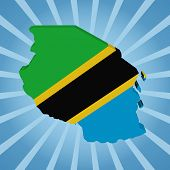 Tanzania map flag on blue sunburst illustration