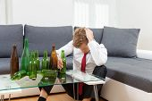 Depressed Businessman Drunk At Home