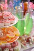 Sweets and bottles of drink with straw close up