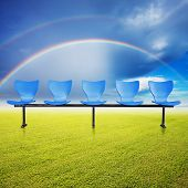 grass field with rainbow in the sky
