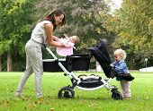 Mother And Daughters With Pram Outdoors
