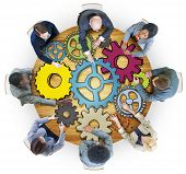 Group of People with Gear Symbol in Photo and Illustration