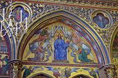 PARIS, FRANCE - SEPTEMBER 13, 2013: Painting and carving in Sainte-Chapelle. The chapel retains one