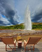 Pillar of hot water and steam from forcing its way out of the ground.  Geyser Strokkur in Iceland. T