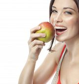 portrait of attractive  caucasian smiling woman isolated on white studio shot eating apple