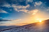 Winter landscape with a sunset. Ukraine, the Carpathian mountains.